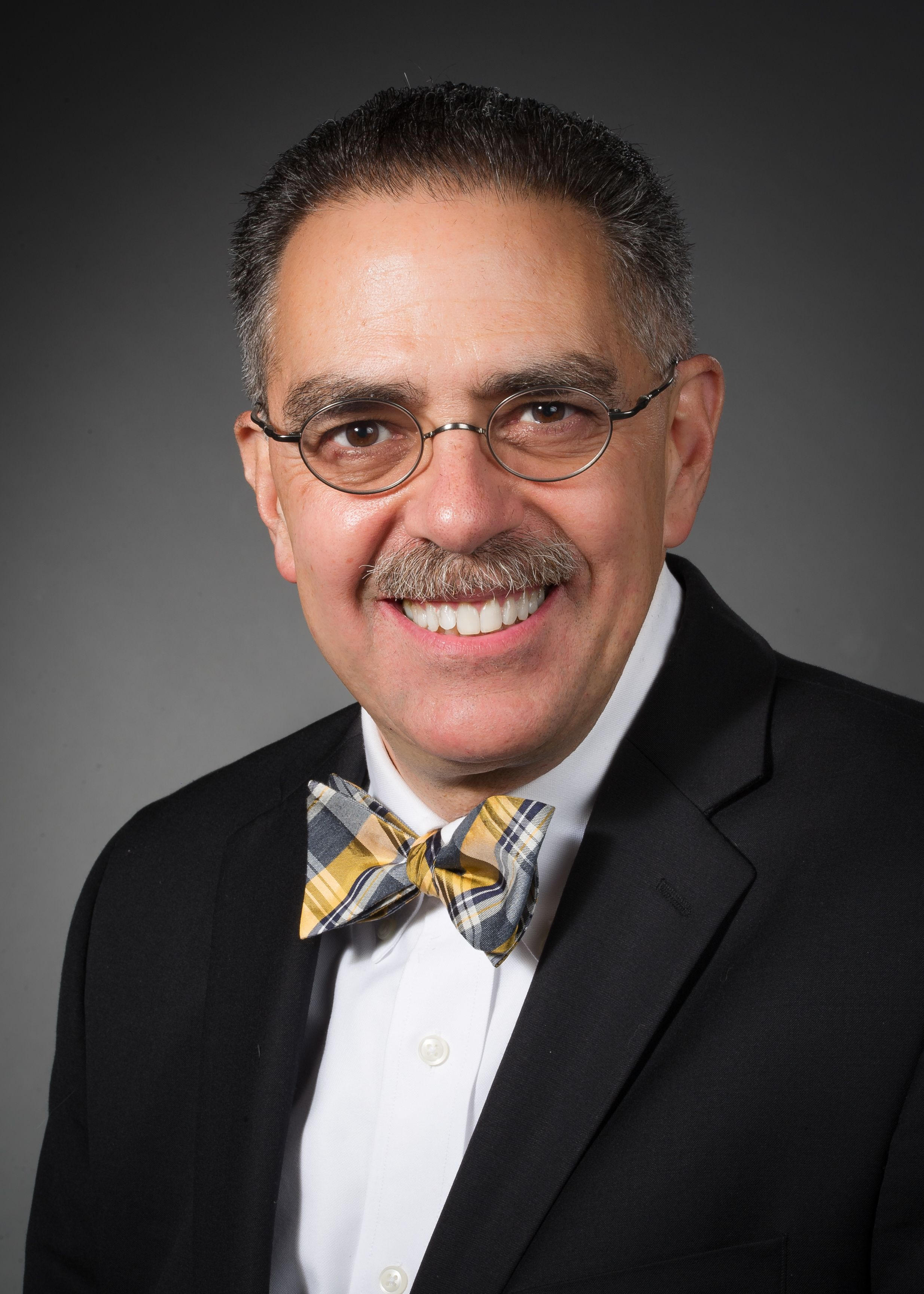 Louis Kavoussi, MD, wearing a gold and grey bowtie