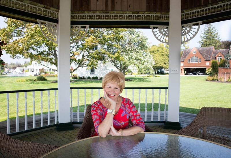 Susan Imbert sitting in the gazebo