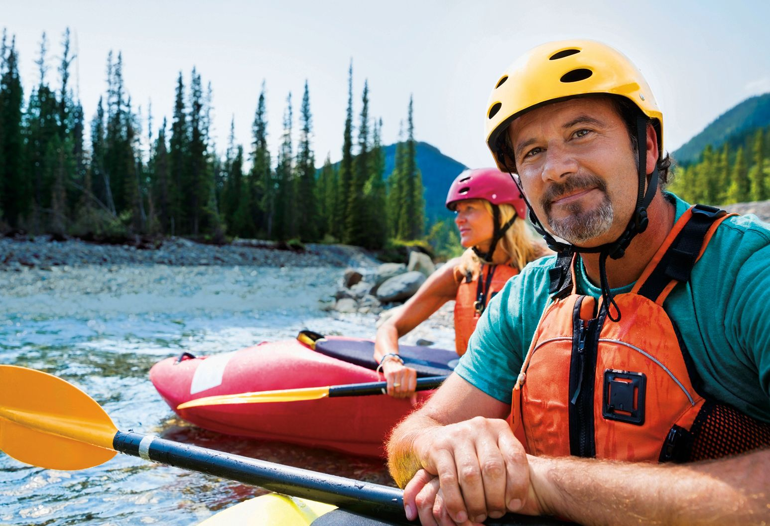 Portrait of confident man kayaking in river