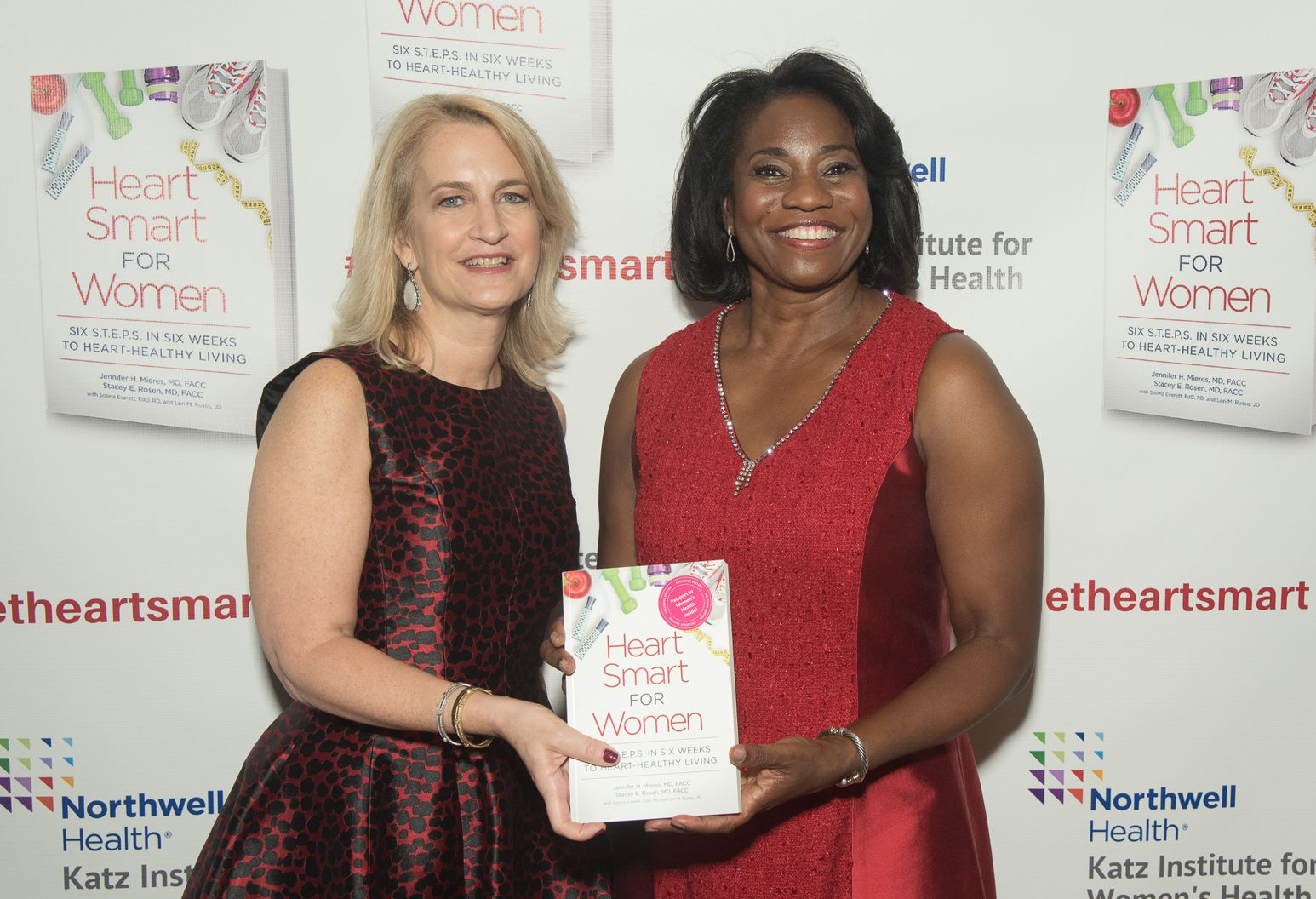 Stacey Rosen and Jennifer Mieres holding Heart Smart for Women