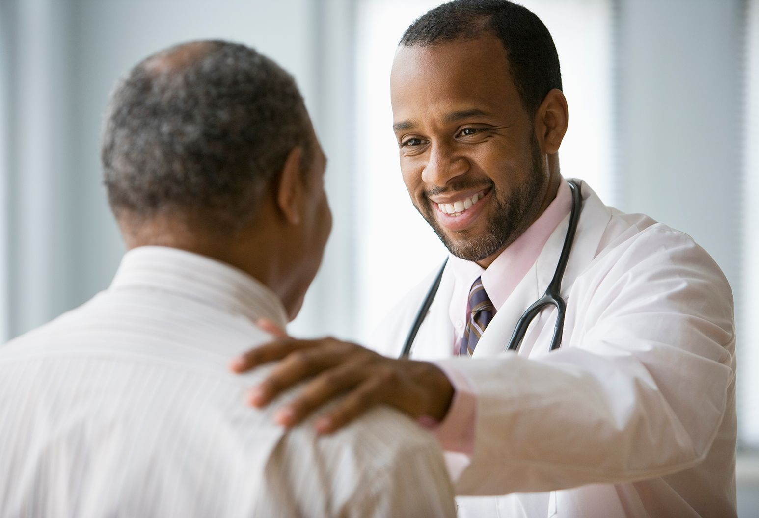 Doctor smiling and greeting patient