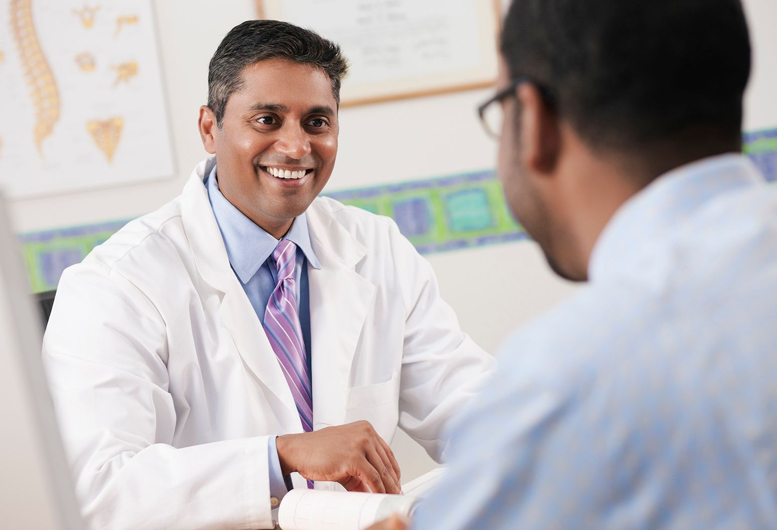 Male doctor smiling with a patient.