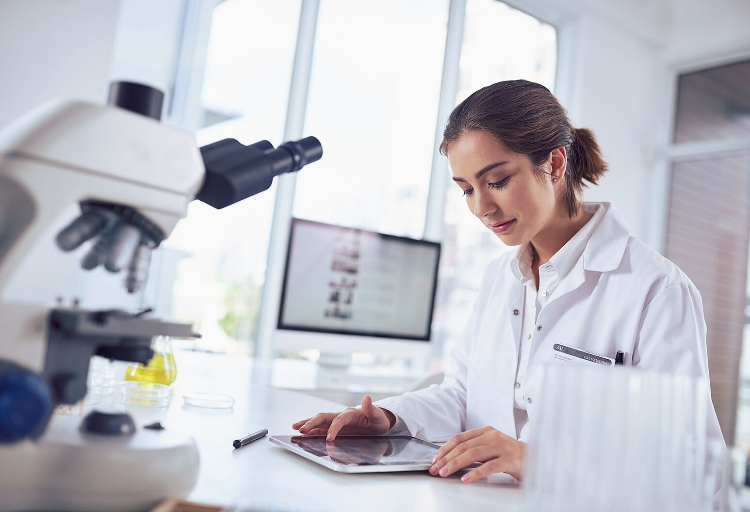 Female researcher in the lab analyzing data based on the latest research project.