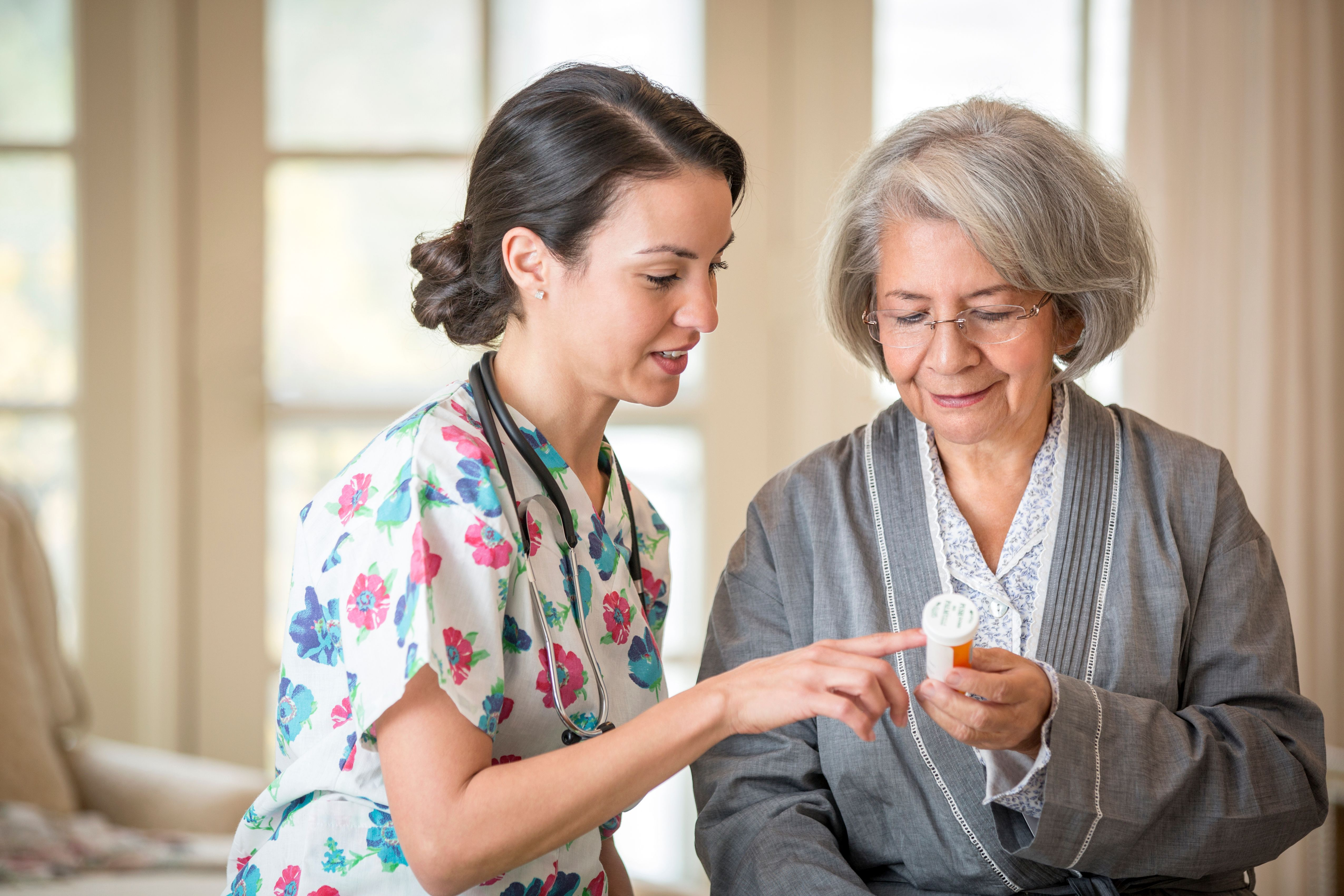 Nurse explaining medication to patient