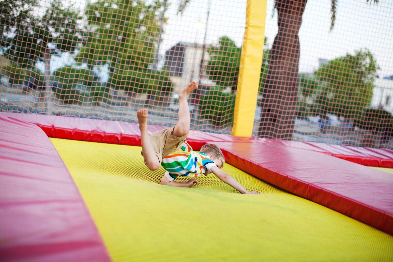 A child falls on a trampoline
