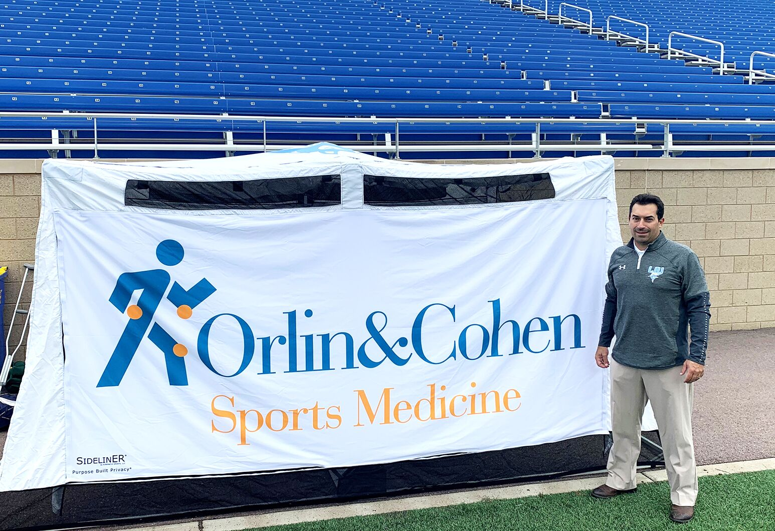 Dr. James Paci at a recent LIU game manning theOrlin & Cohen sideline tent.Courtesy Orlin & Cohen.