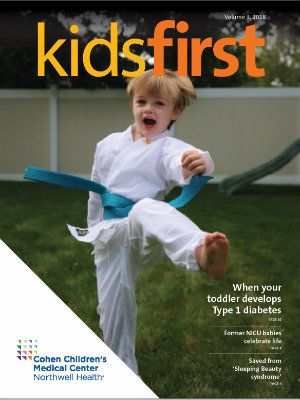 The cover of a 2018 issue of the Kids First pediatric newsletter features Liam Dubno doing karate.
