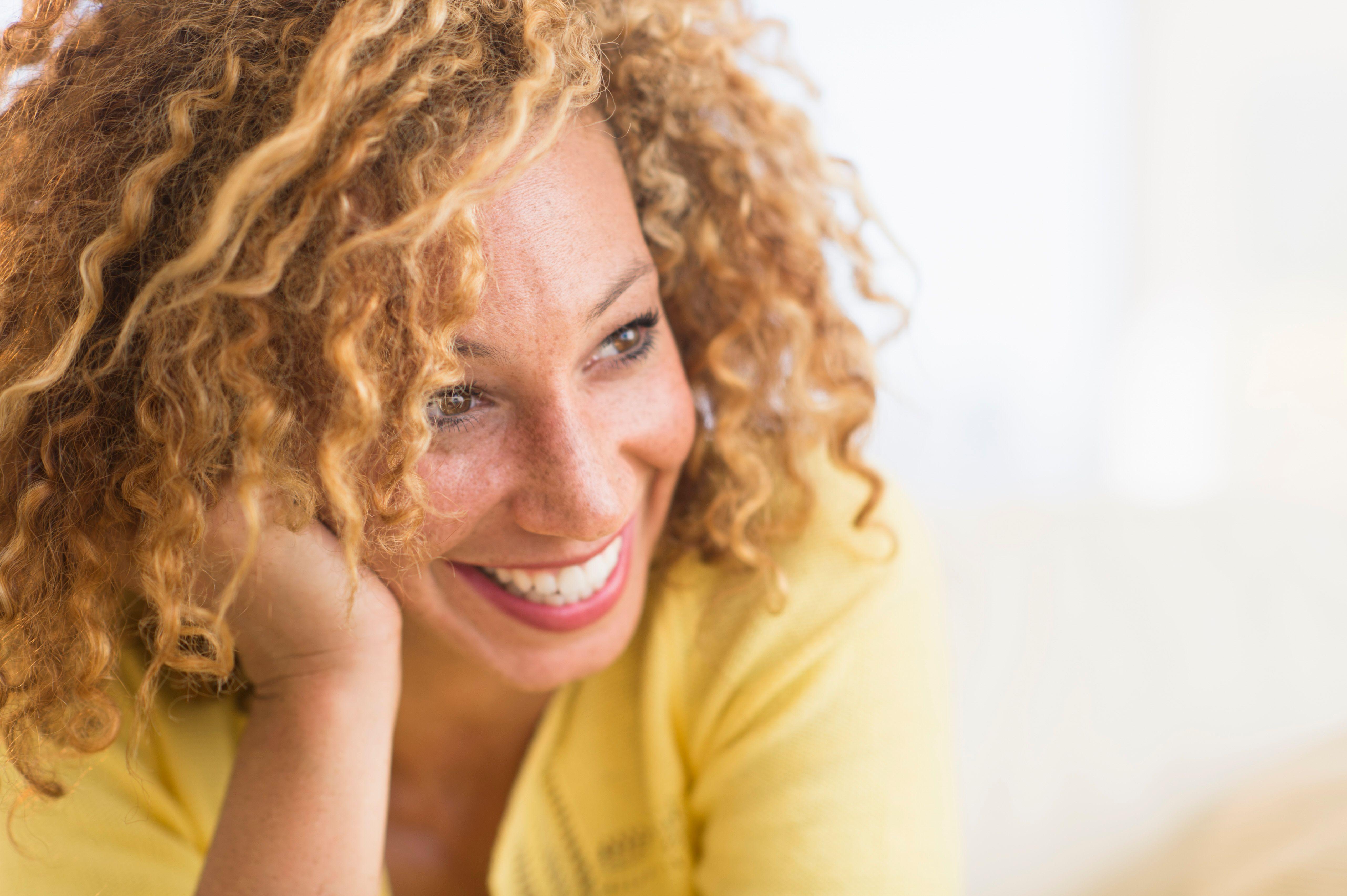 A woman smiles