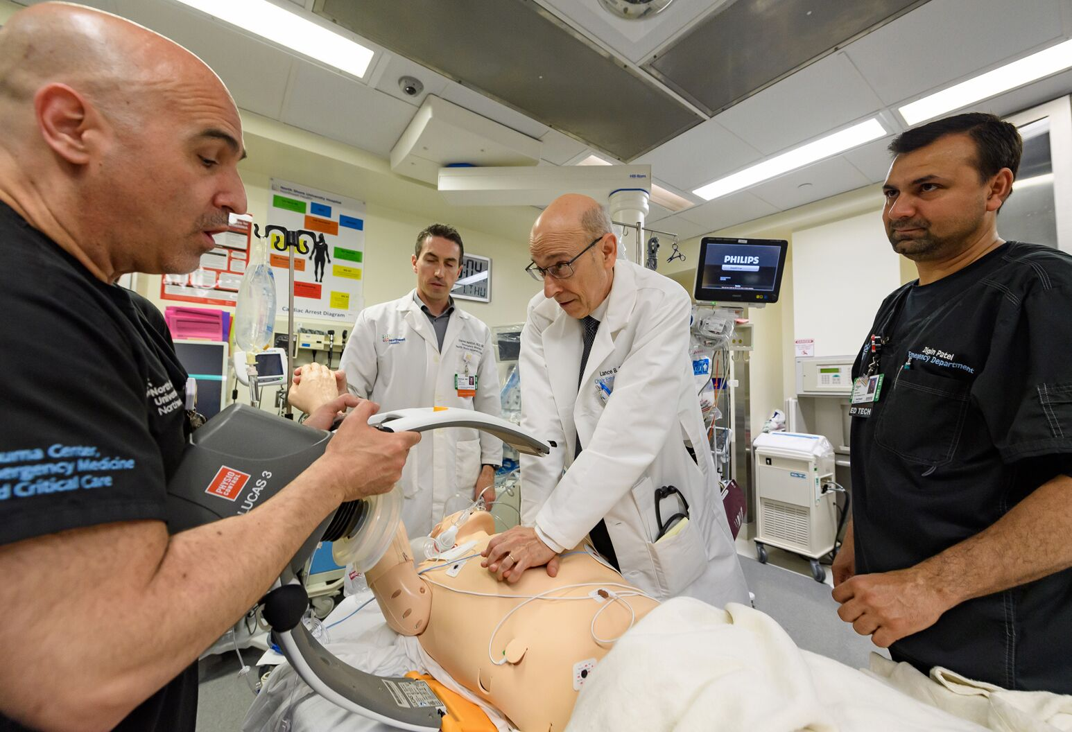 Lance Becker, MD, center, trains his team how to reverse death after 10 minutes or longer.