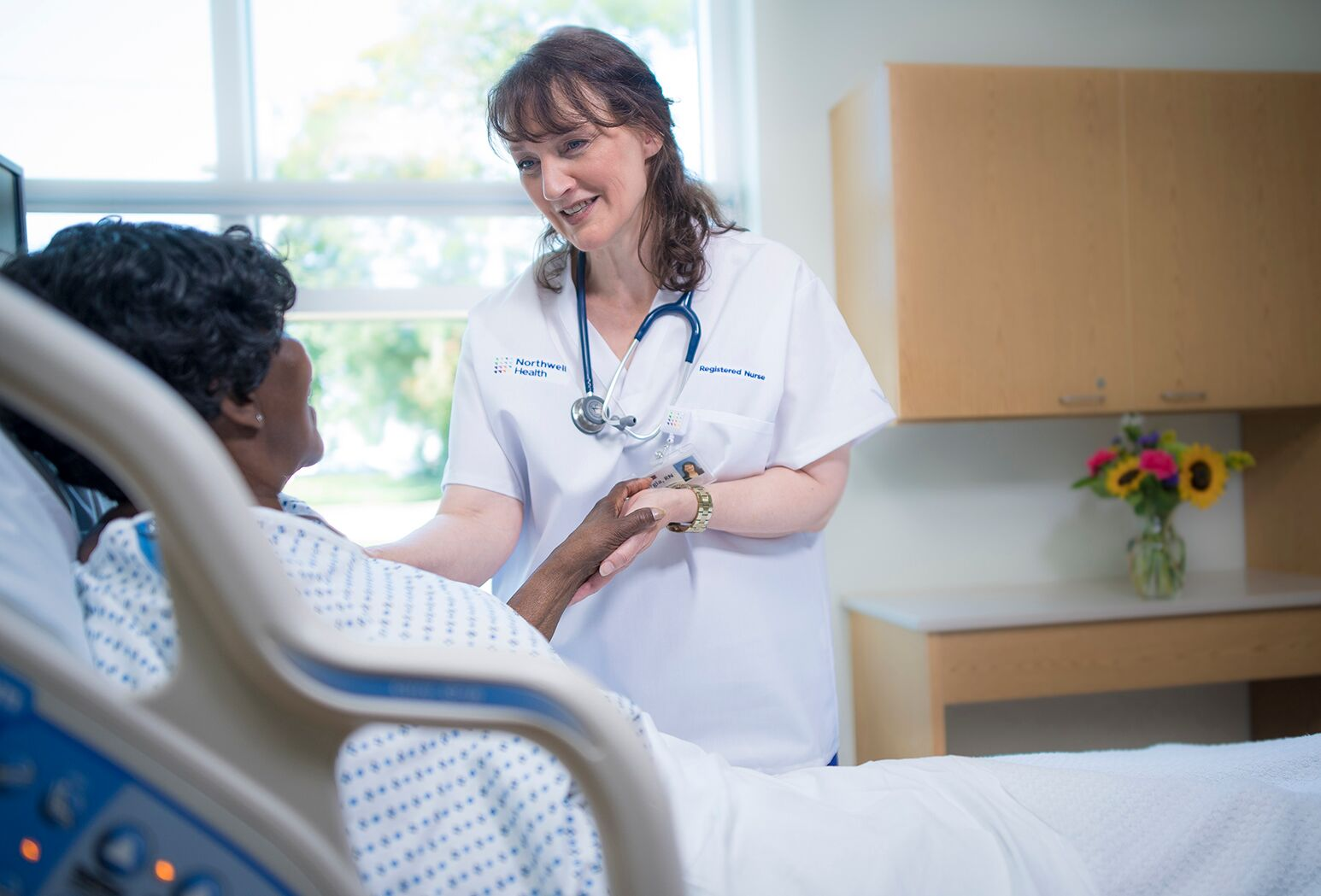 Northwell Health Registered Nursing helping patient