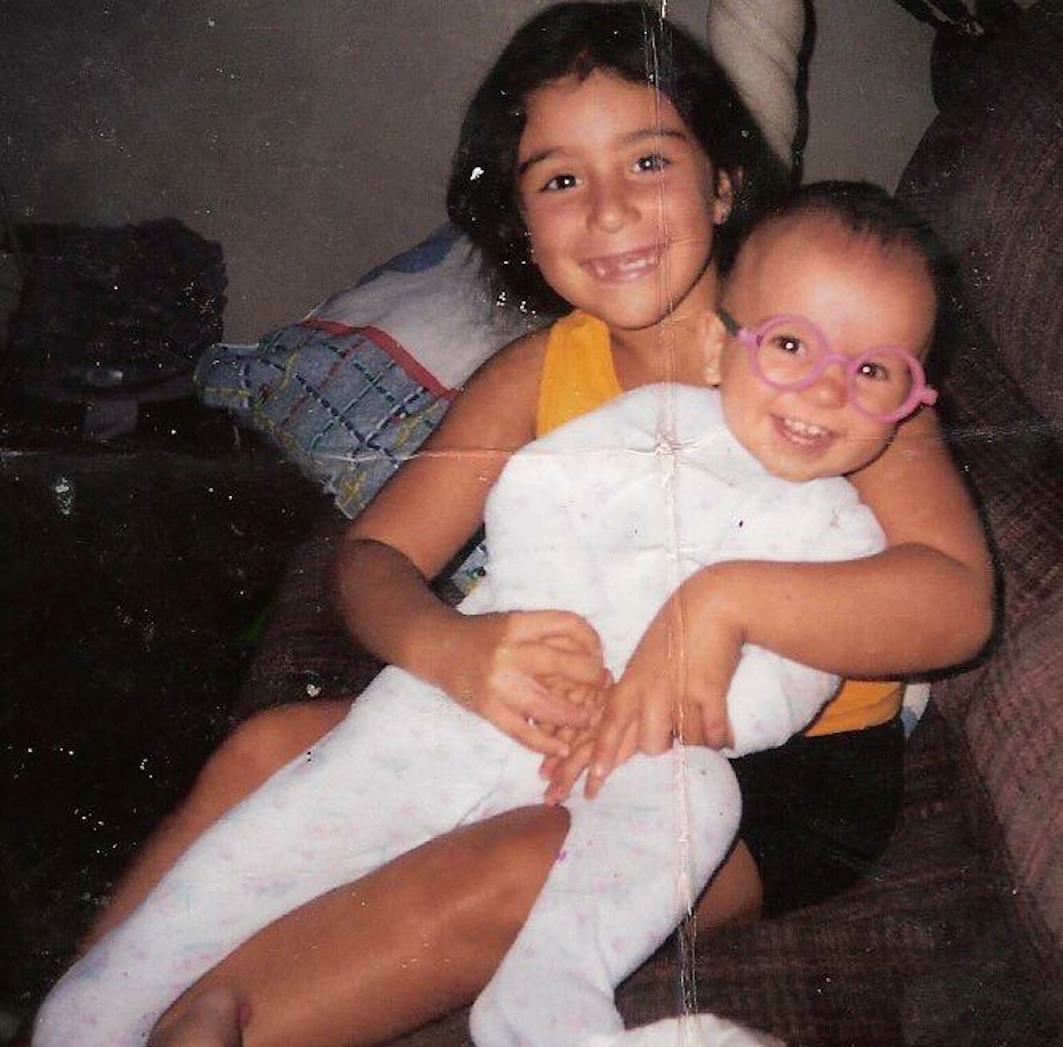 Kimberly at age 8 with her baby sister