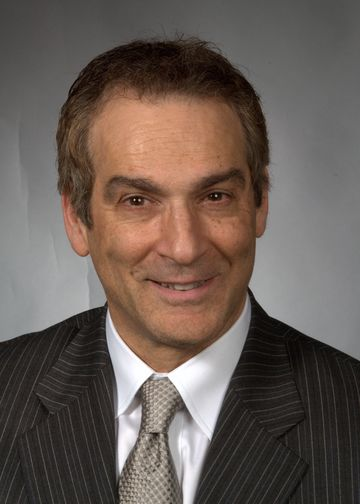 Gene Coppa, MD, wearing a grey pinstriped suit