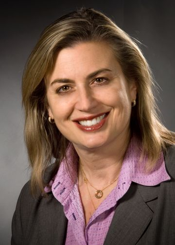Jacqueline Moline, MD, wearing a purple shirt