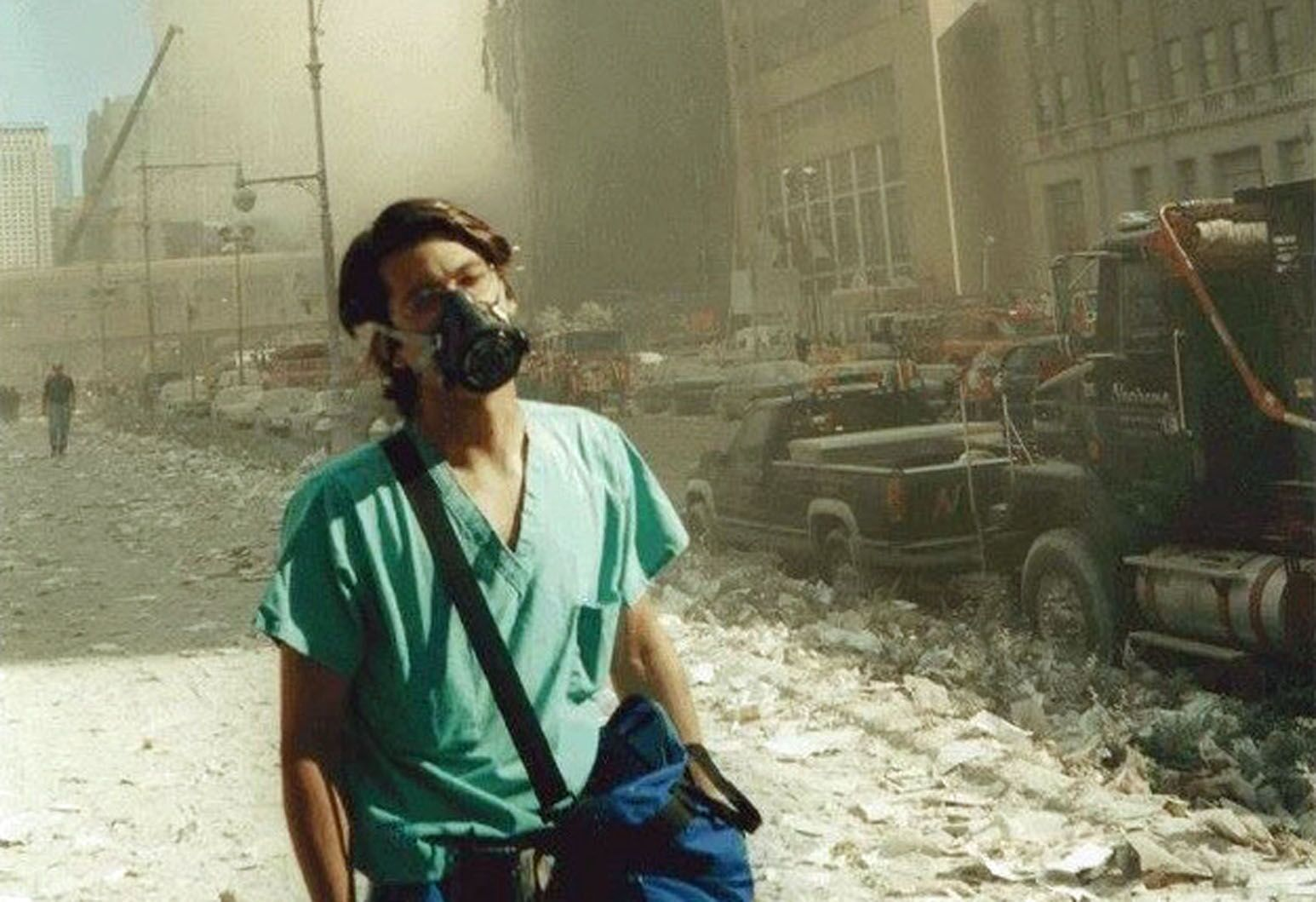 Omar Bholat wears a mask while working in lower Manhattan on September 11, 2001. He provided medical assistance at Chelsea Pier and the Green Zone Triage at South Ferry.