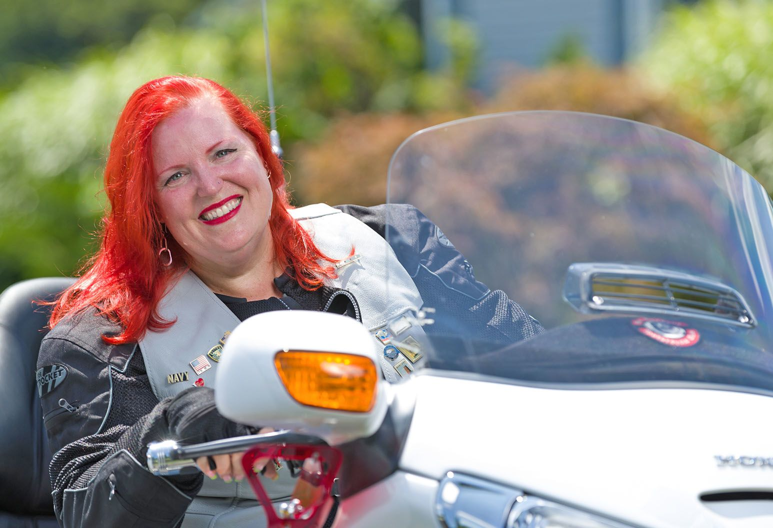 Women with red hair sitting on motorcycle