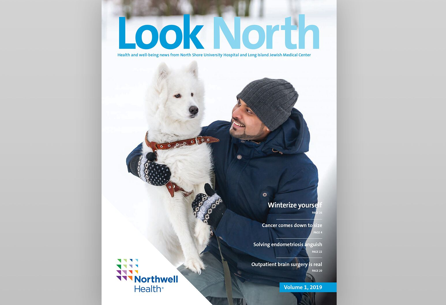 Cover of Look North magazine features a mother, daughter, son and dog