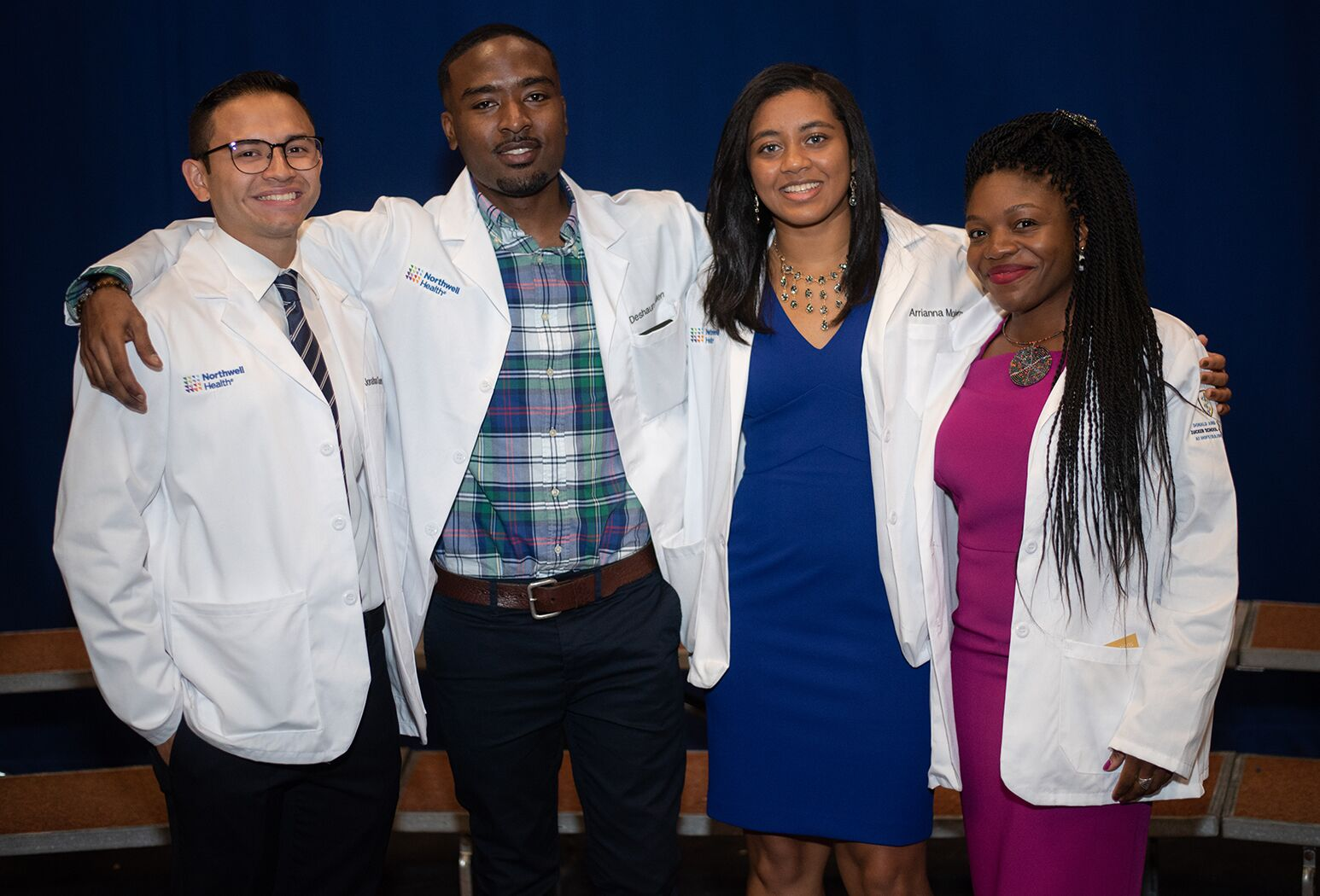From left: Medical students Jonathan Guevara, Deshaun Allen, Arrianna Mohammed, and Joy Achuonjei celebrate the start of the journey to become medical doctors.