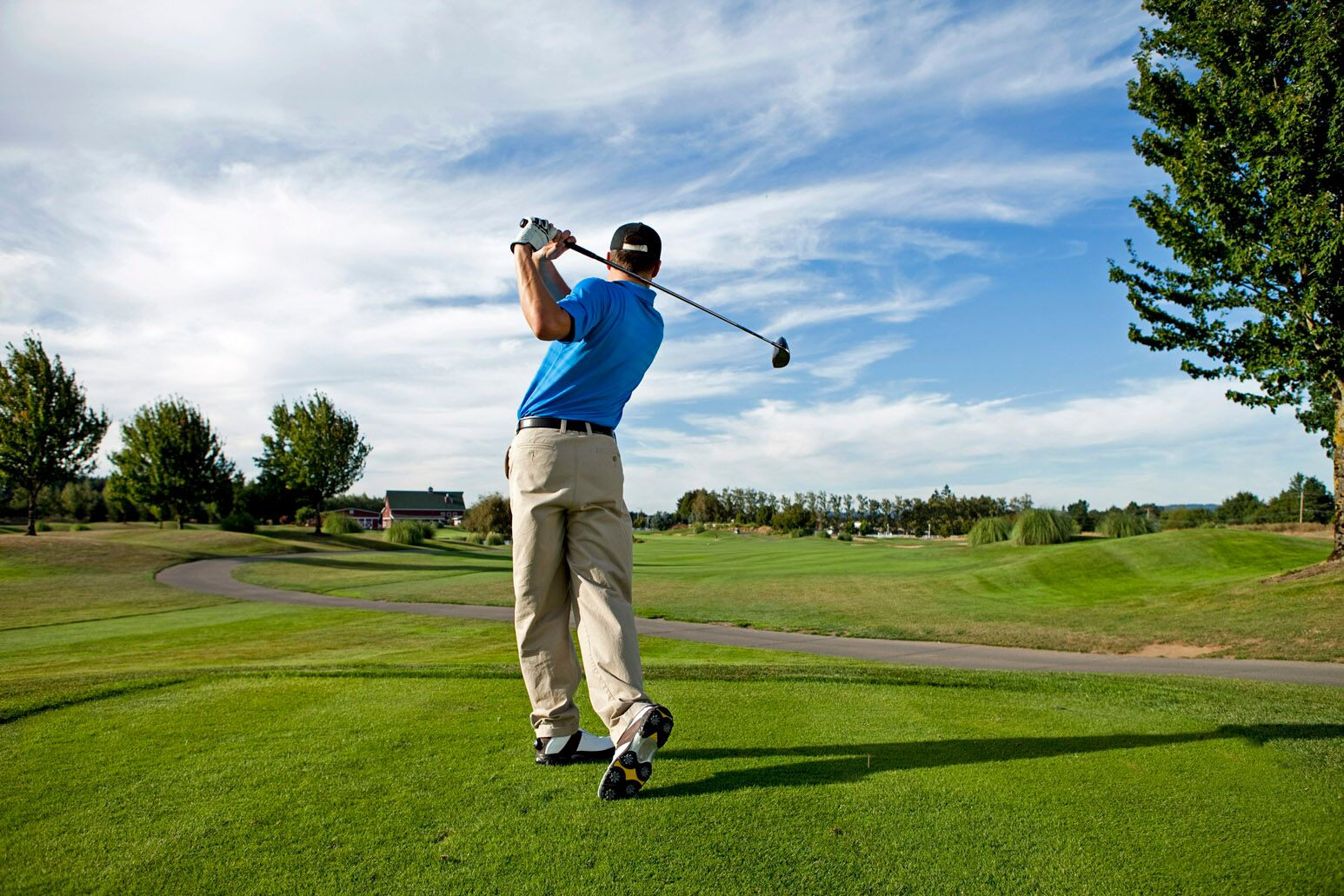 A male golfer takes a swing. Randy Cohn, MD, discusses common golf injuries and shows how you can prevent them.