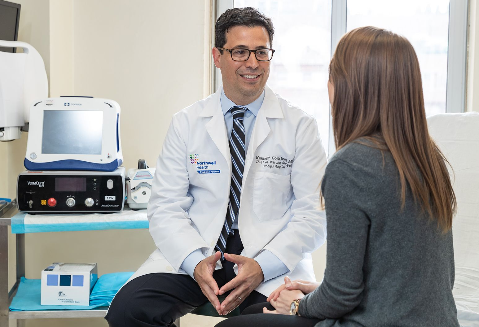 Male doctor and a female patient discussing the outcome of a recent procedure.