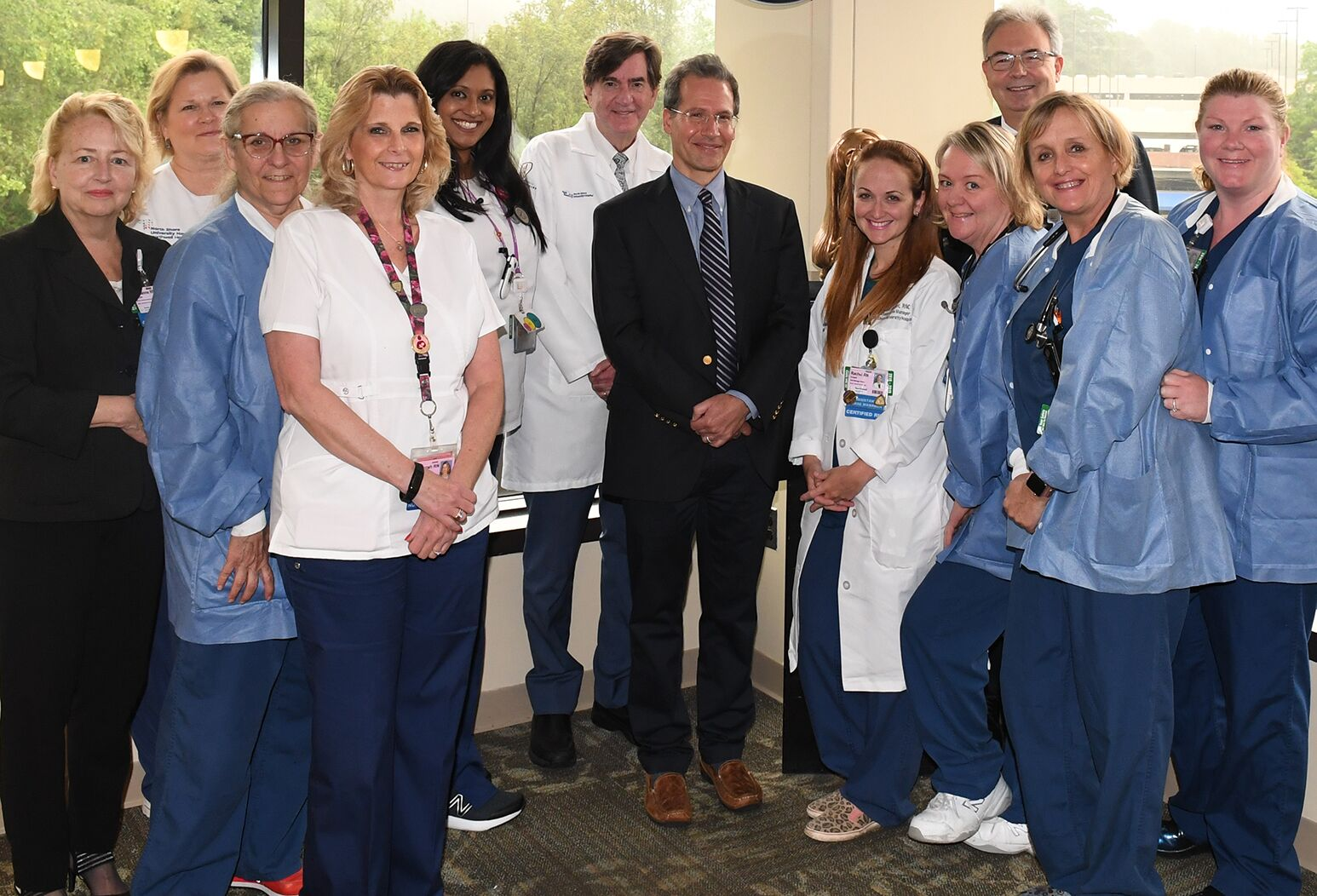 Marianne McTyre, RN, director of Patient Care Services (far left); Dr. Burton Rochelson, chief of Maternal Fetal Medicine (6th from left); Dr. Greg Palleschi, director of OB Anesthesiology (7th); and Dr. Leo Penzi, vice chair of Anesthesiology (10th).