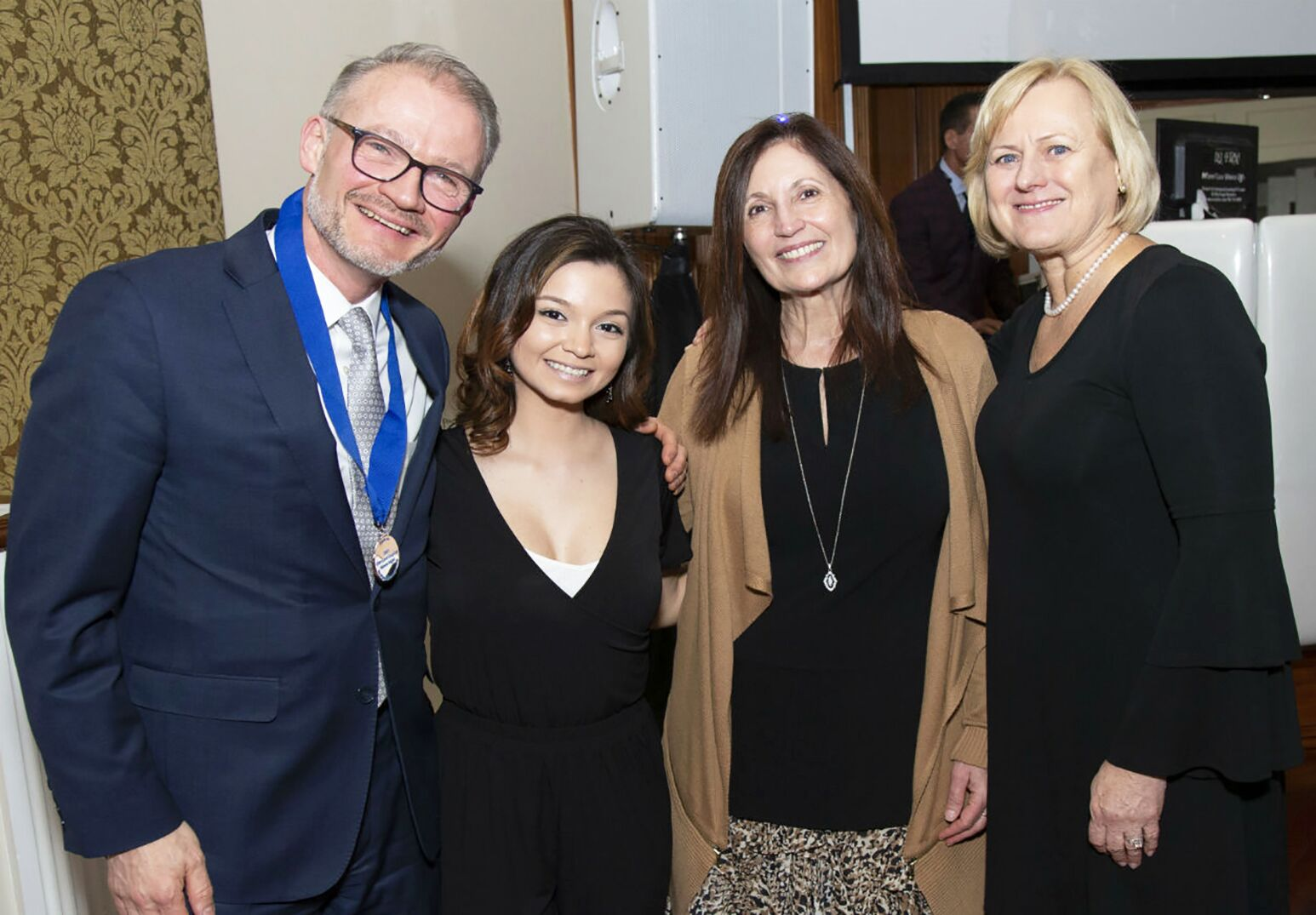 One of Glen Cove Hospital's 2019 Heroes Night patients, Jessica Bohorquez, with Northwell Health's Sven Gierlinger and Glen Cove Hospital's Susan Kwiatek, DNP, and Doreen O'Grady, RN.