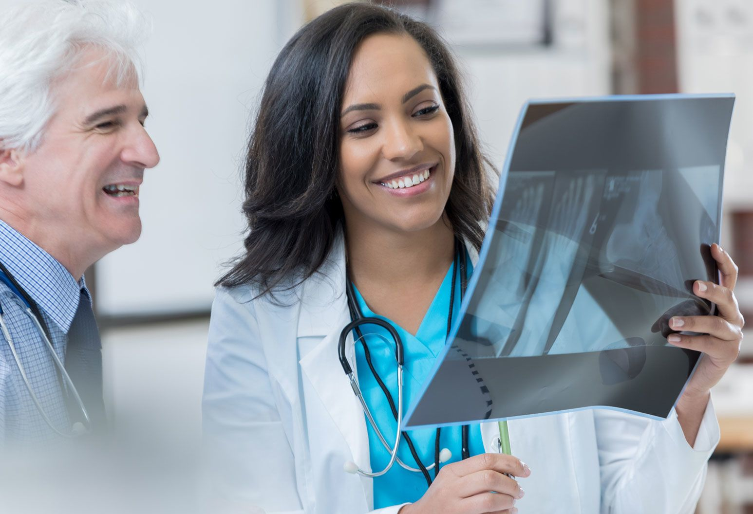 Two physicians looking an x-ray together