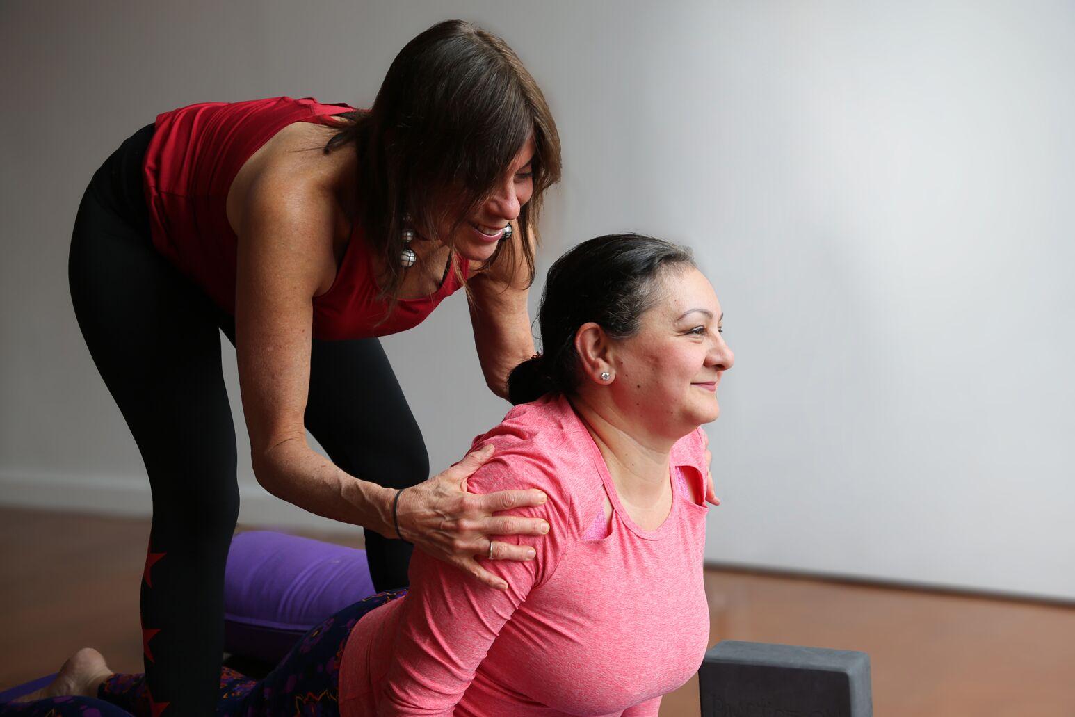 Kathy Khodadadi with her yoga trainer