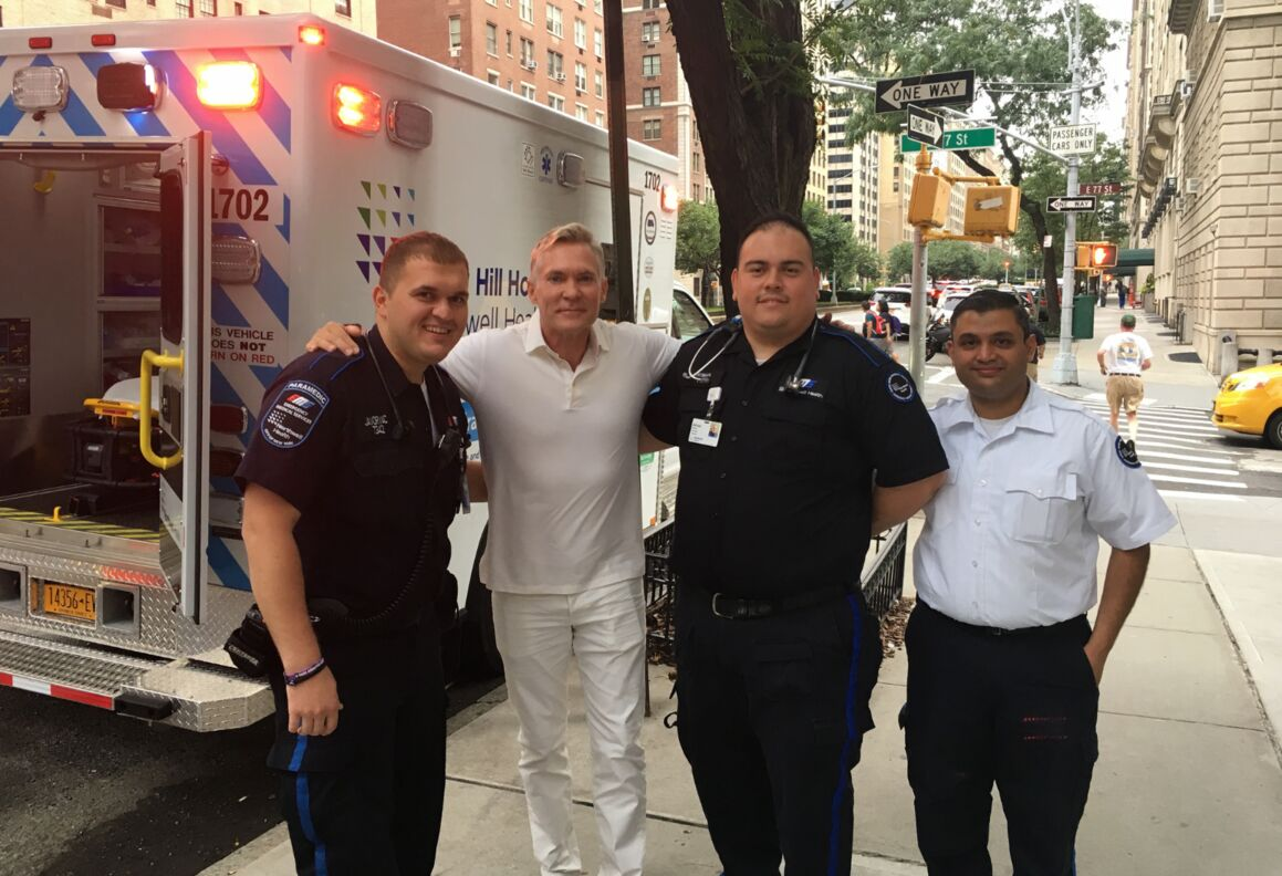 Lenox Hill Hospital EMTs with weatherman Sam Champion.