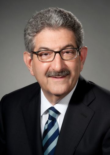 Ira Udell, MD, wearing a navy blue and light blue tie