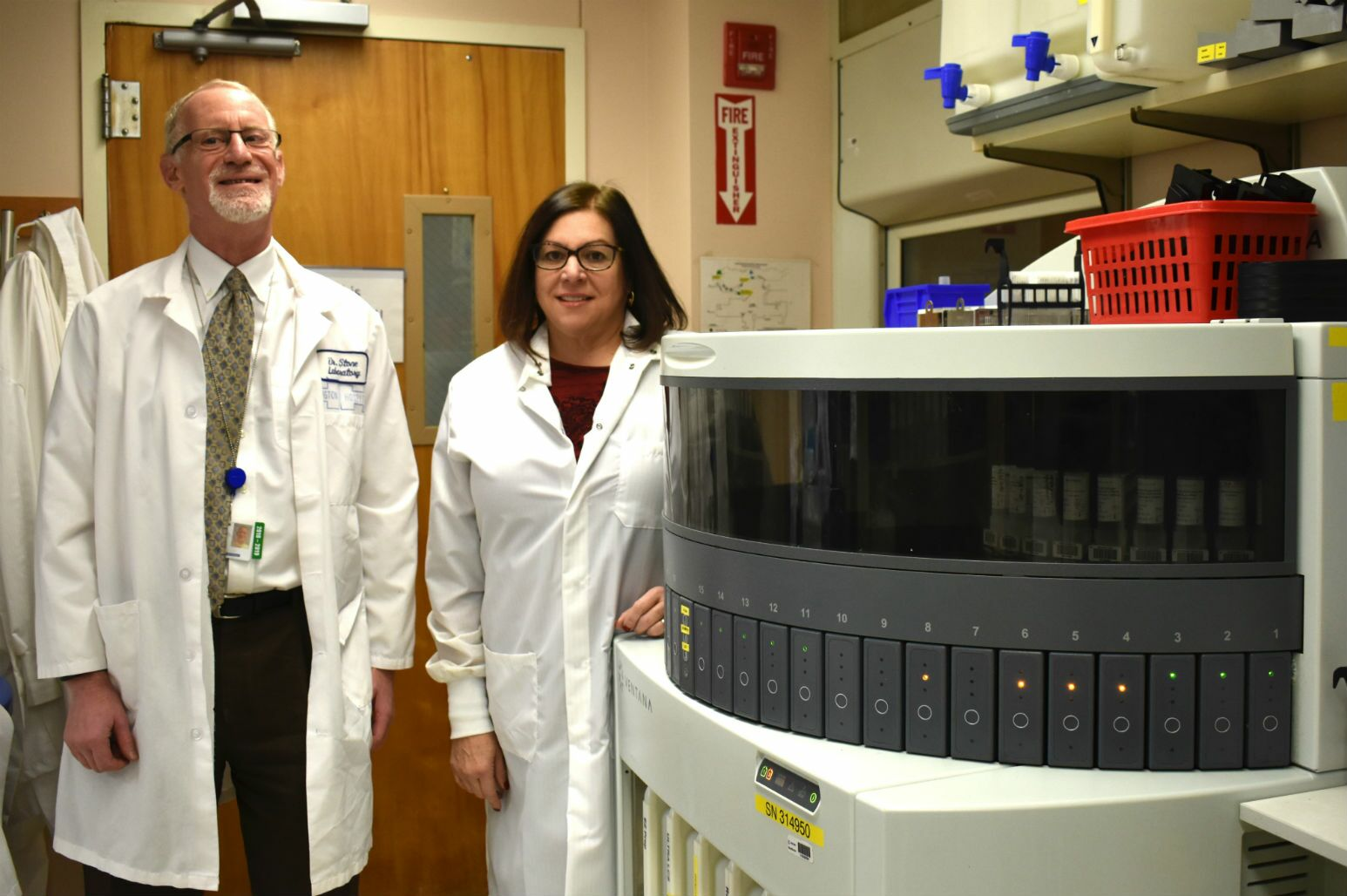 Huntington Hospital's Dr. Gary Stone and Susan Schwartz with the Ventana Benchmark Ultra machine that helps analyze PD-L1 samples.