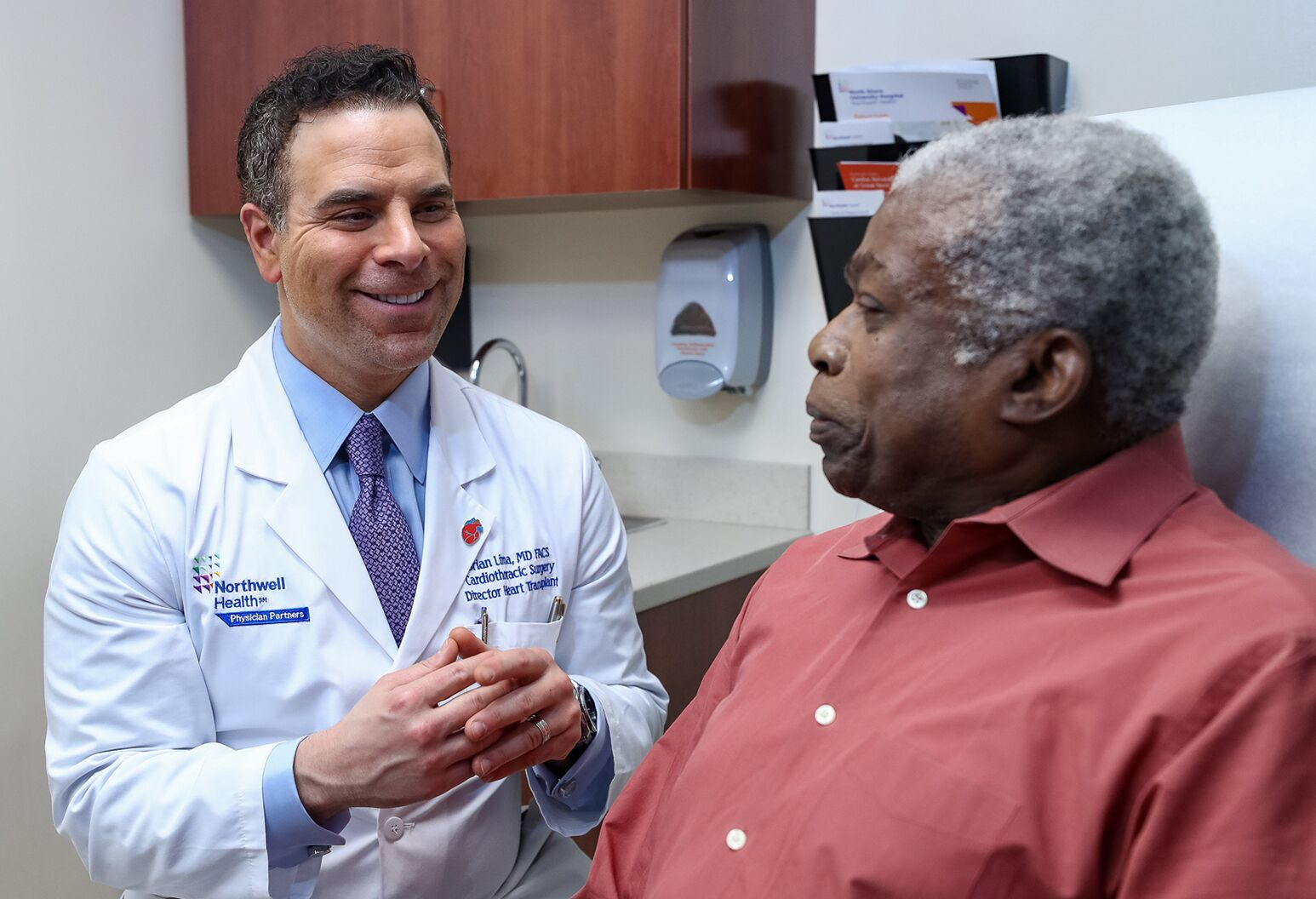 Brian Lima, MD, discusses advanced heart failure with a black patient.