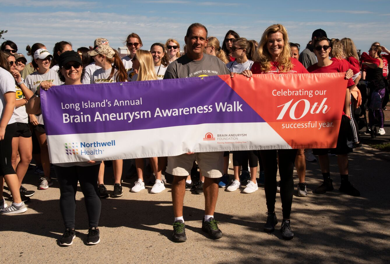 Brain aneurysm survivors, along with their families and friends, help to raise awareness at annual walk.
