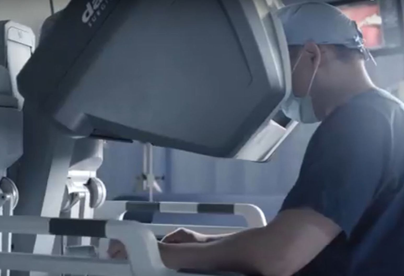 A doctor using a robotic surgery machine.