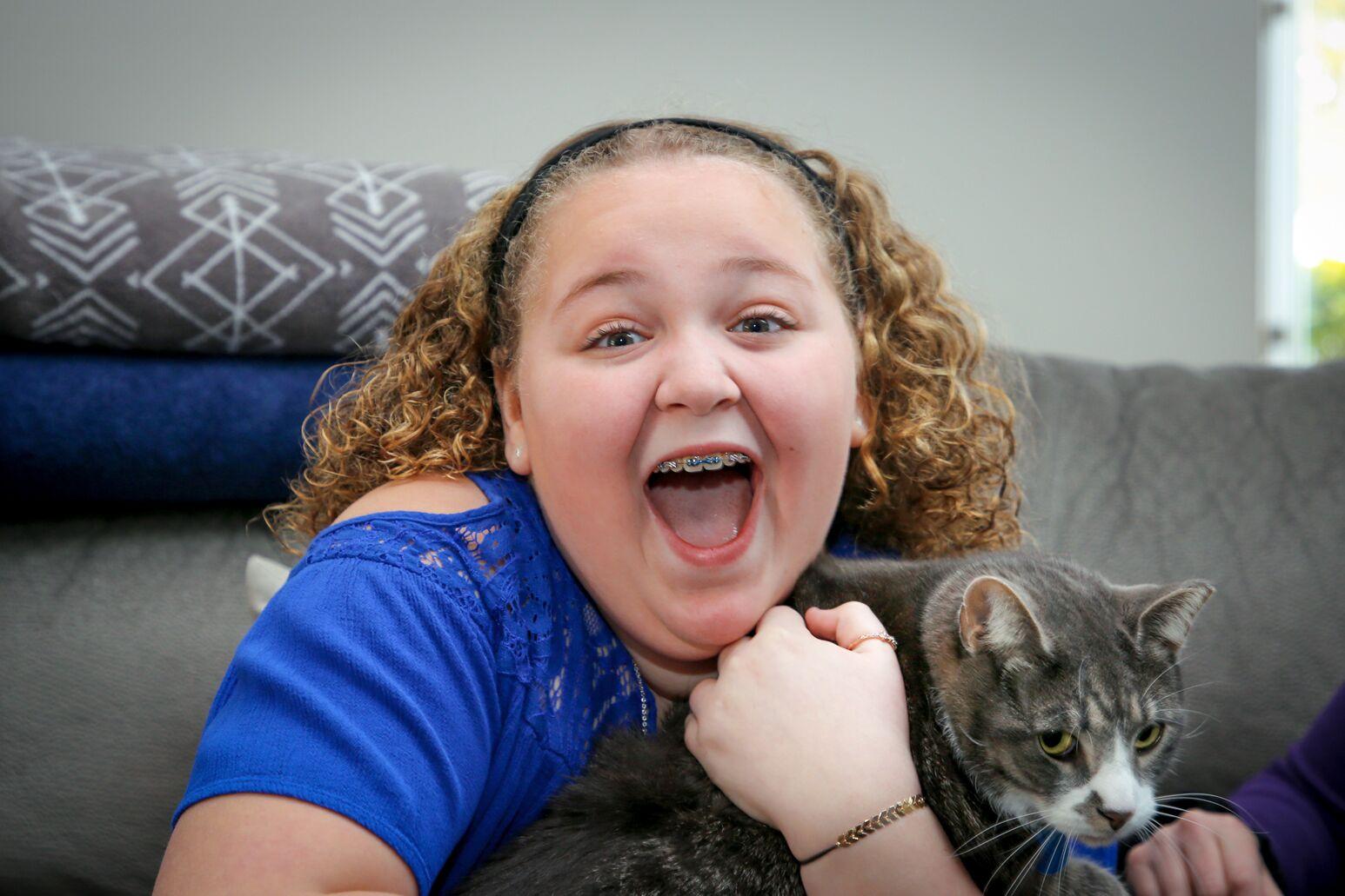 Adrianna Linett holding her cat.