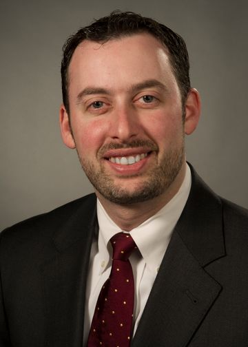 Michael Goldberg wearing a maroon tie
