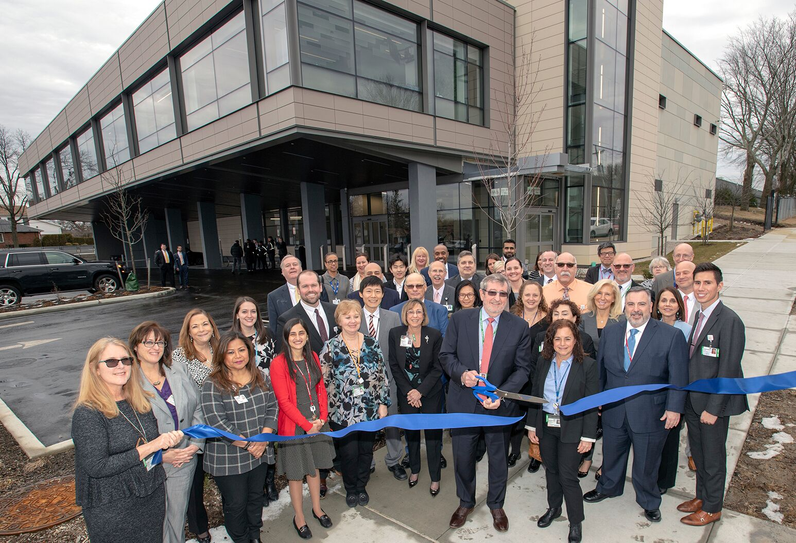 Michael Dowling with the Northwell Health Labs team at the opening of a $47.7 million shared, centralized laboratory in Little Neck, Queens.