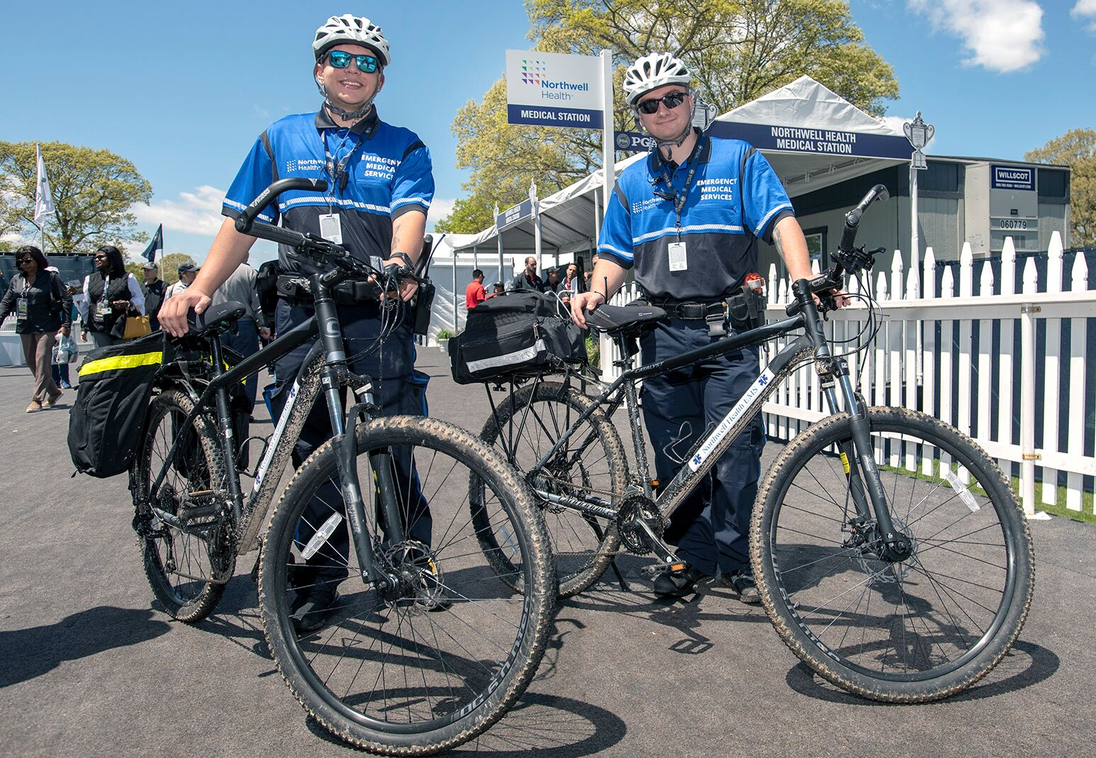 Northwell EMTs on mountain bikes patrol Bethpage State Park during the PGA Championship.