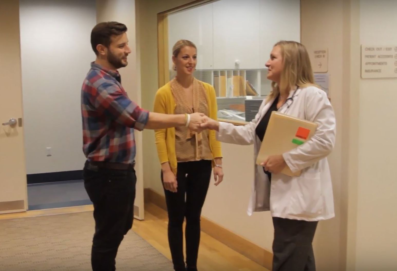 Woman and man couple meeting fertility staff