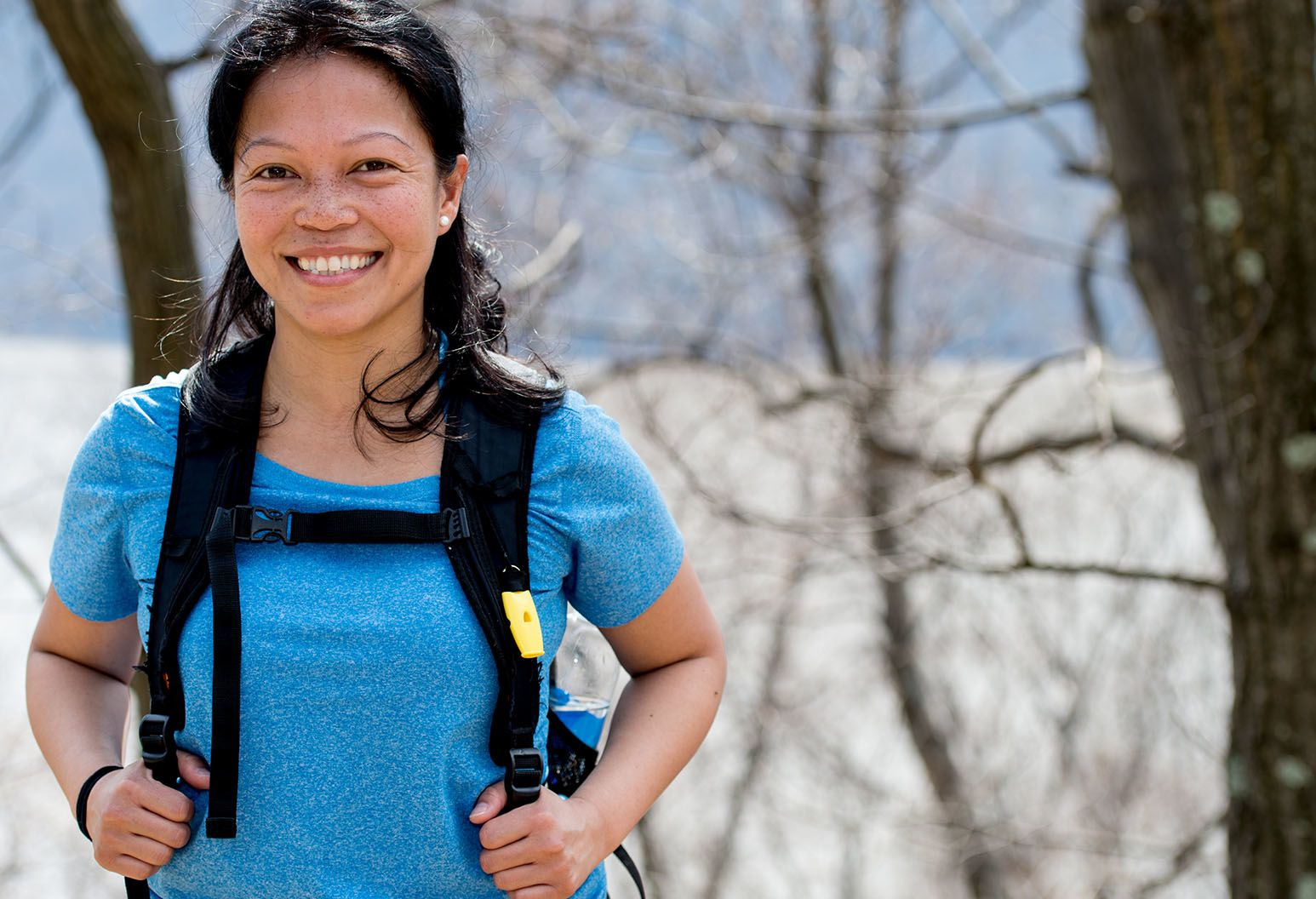 Woman standing outdoors in hiking gear