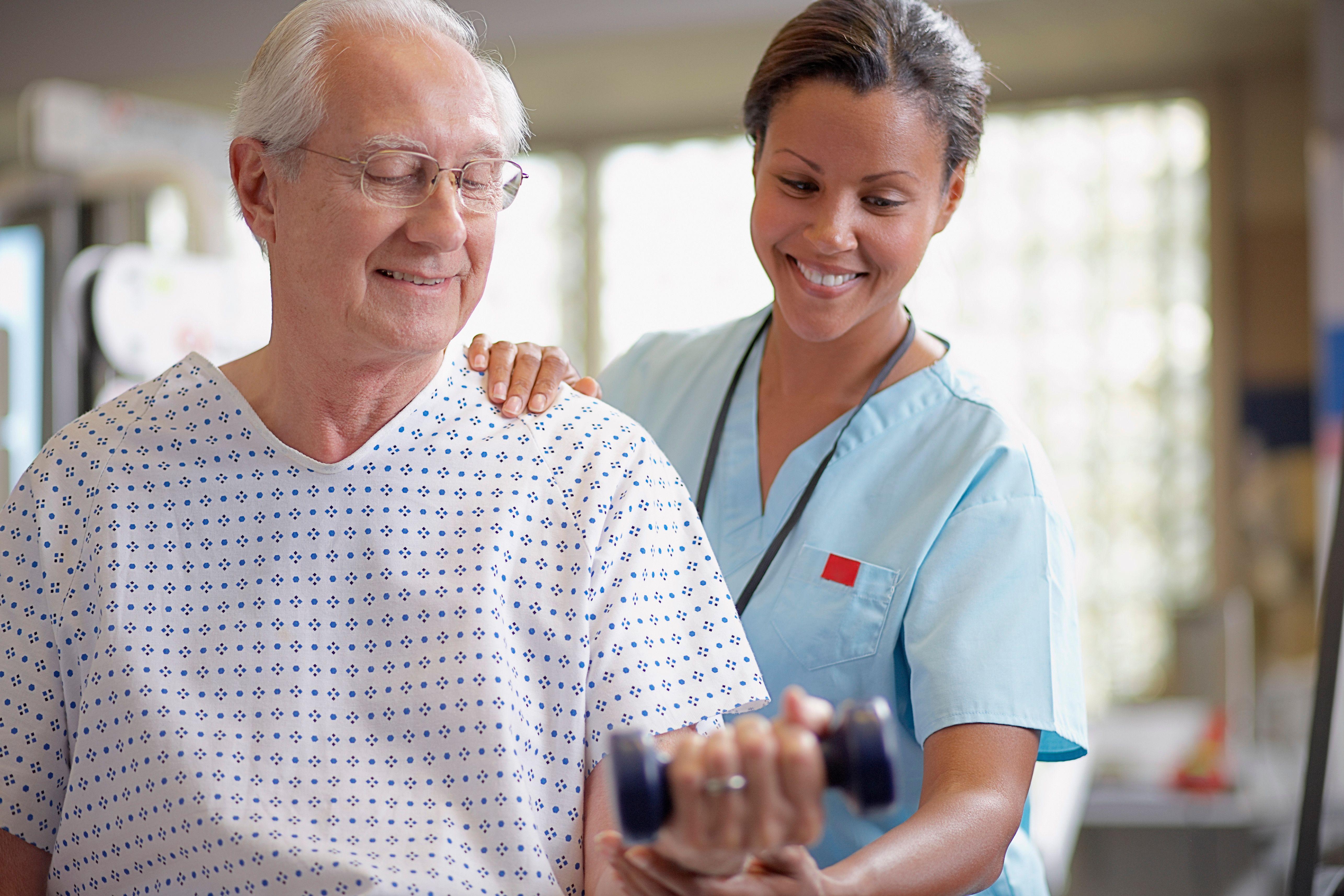 A female nurse works with an elderly man
