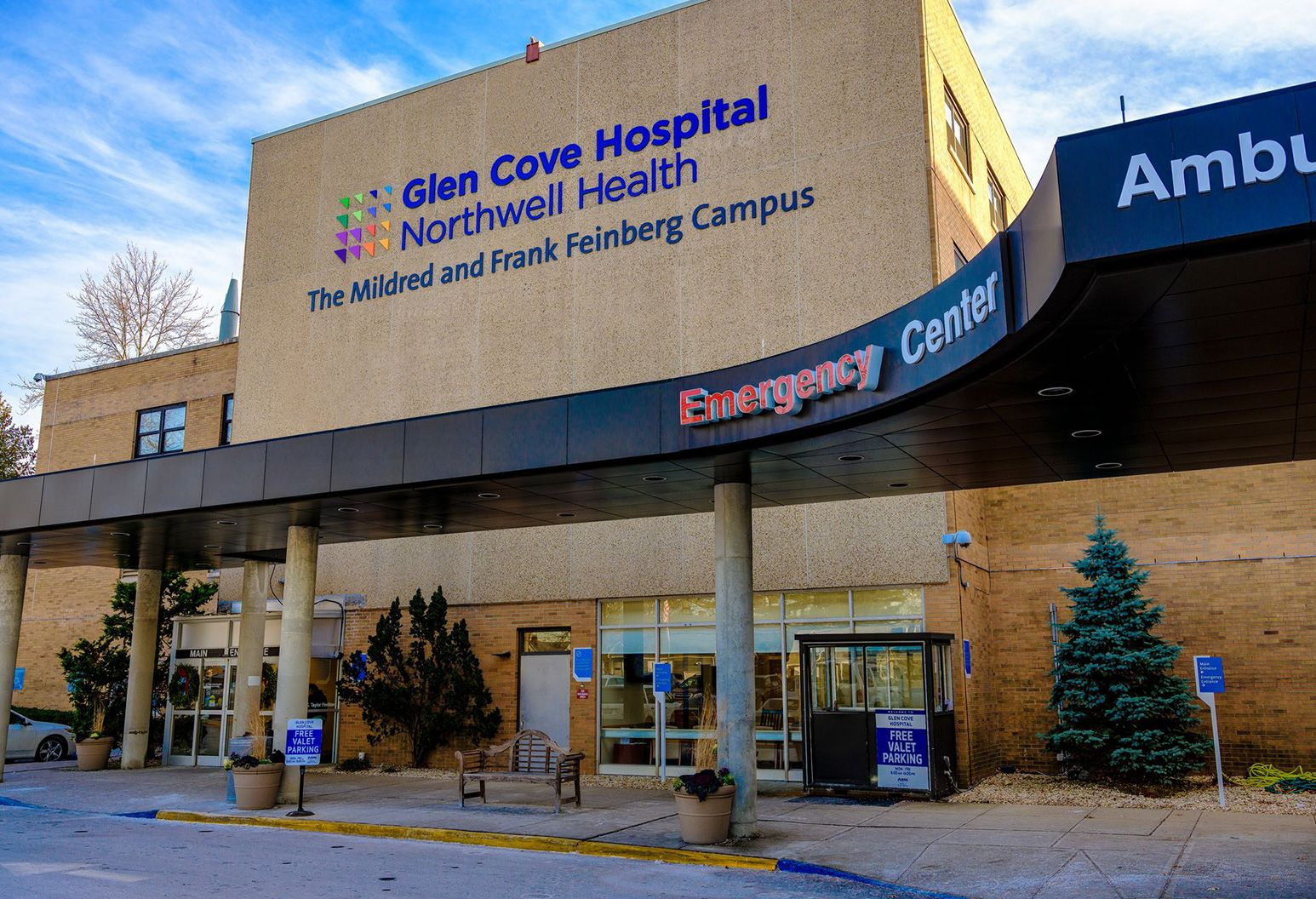 Exterior  of Glen Cove Hospital focusing on the Emergency entrance.