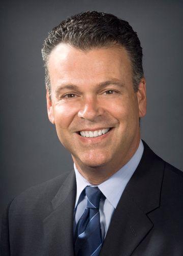 David Battinelli, MD, wearing a blue shirt and blue tie