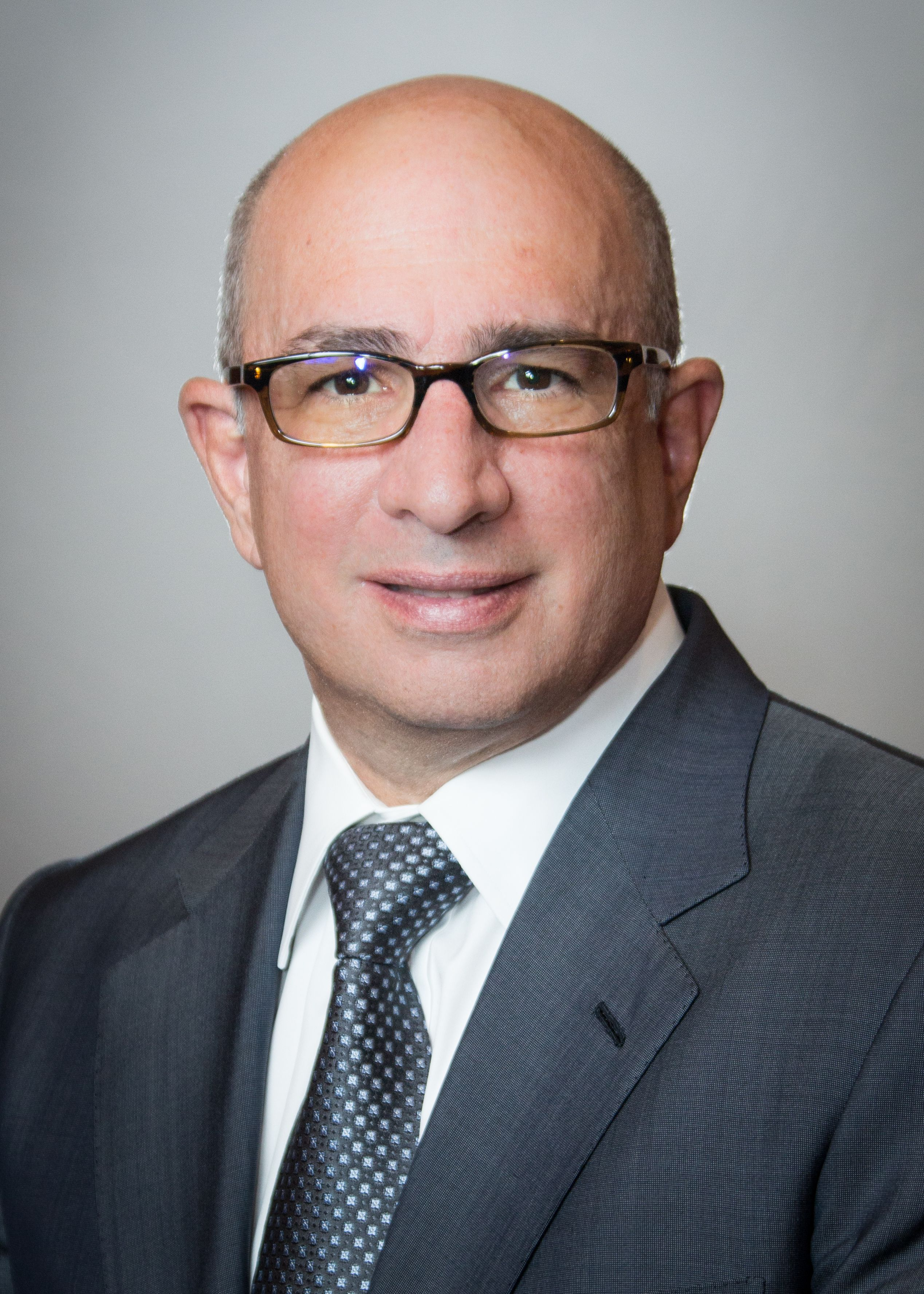 Peter Costantino, MD, wearing a black and silver tie