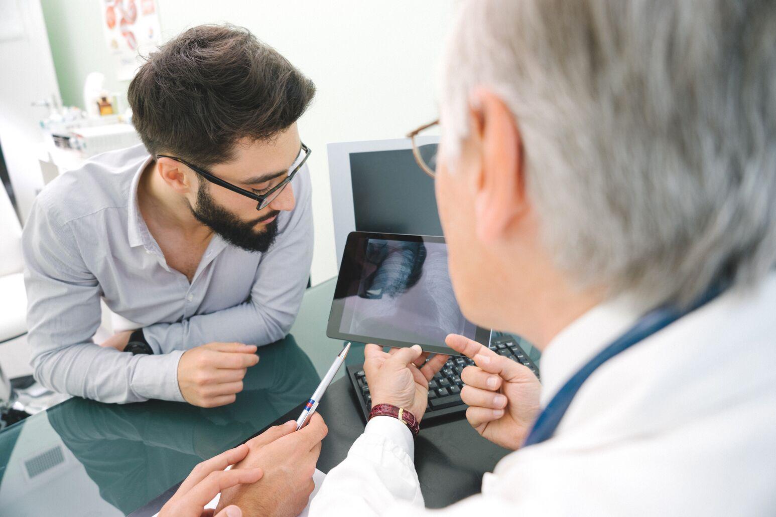 Clinicians review diagnostic imaging