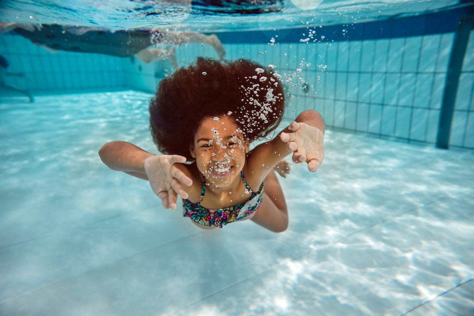 A girl swims under water