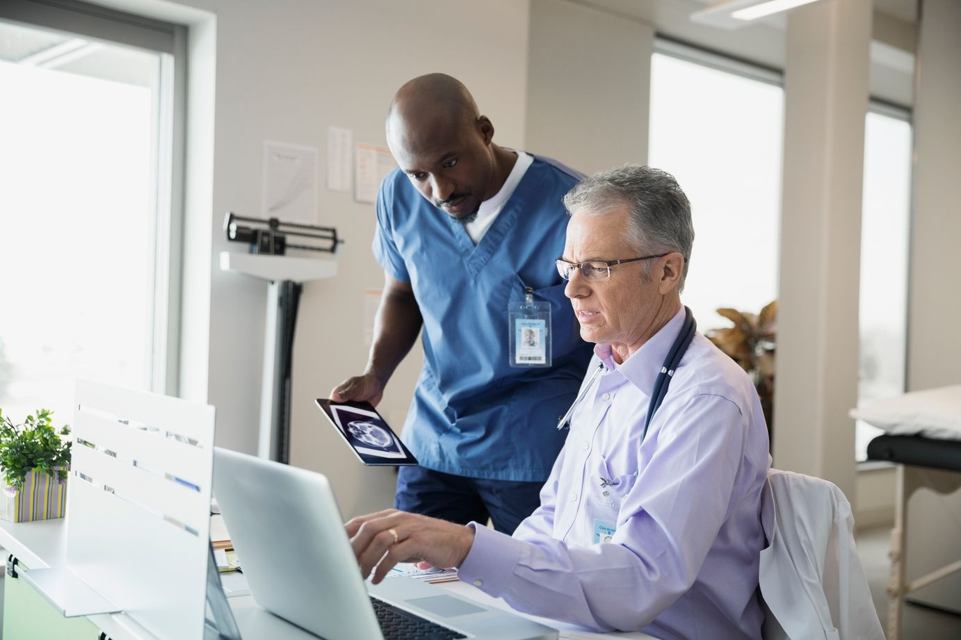 Two clinicians review a case