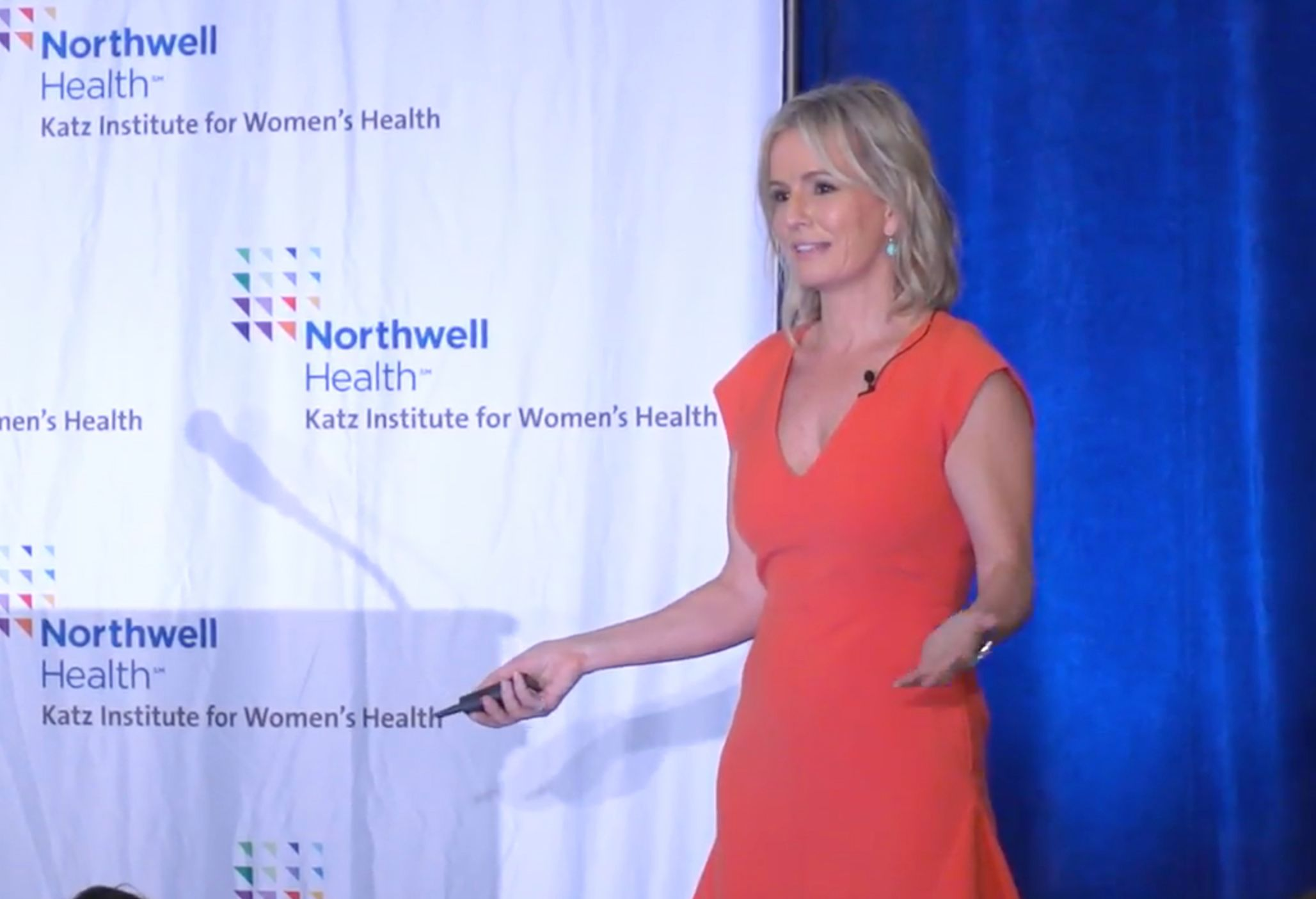 Dr Ashton speaking at a women's health conference.