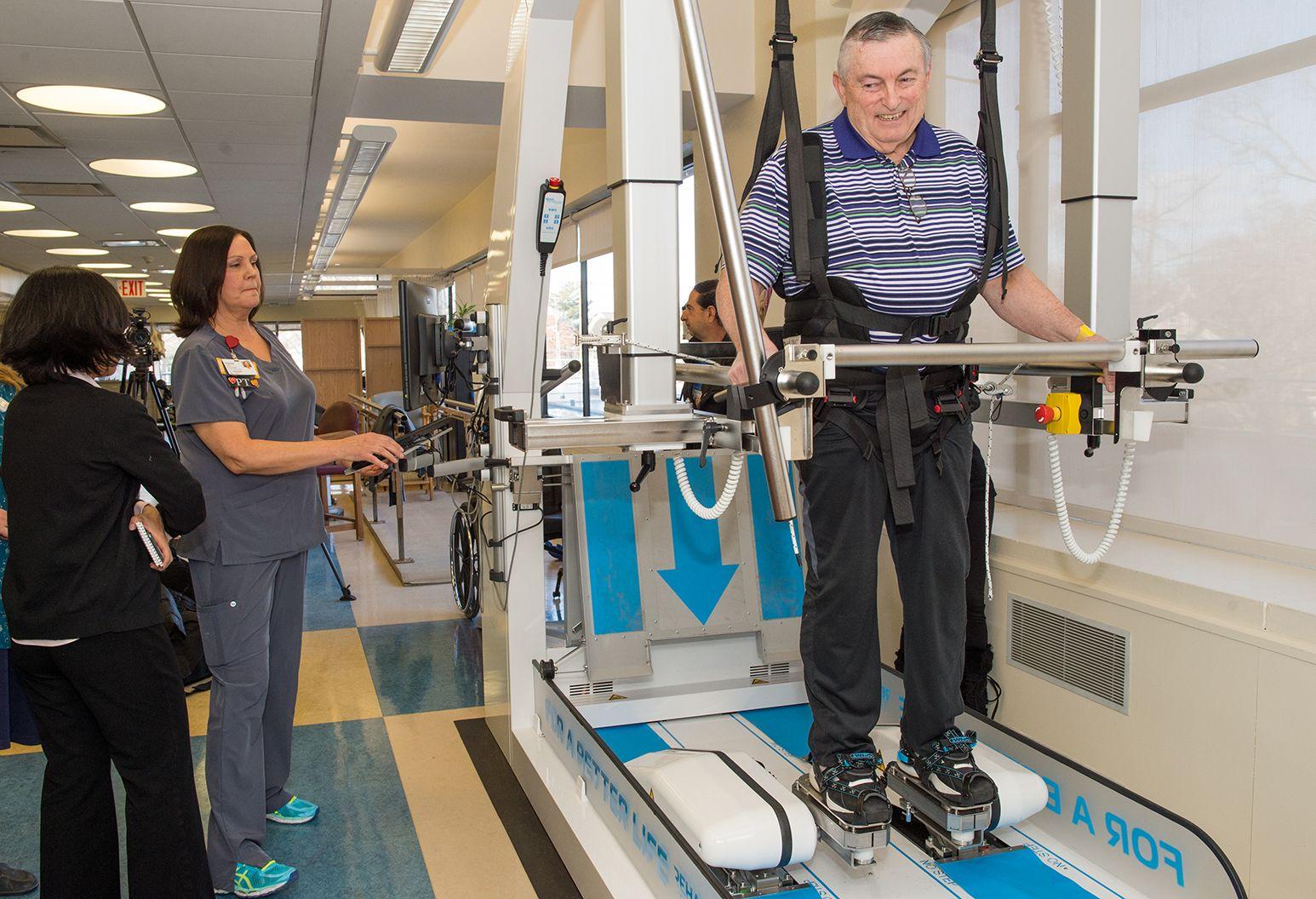 Elderly man using new machine to walk
