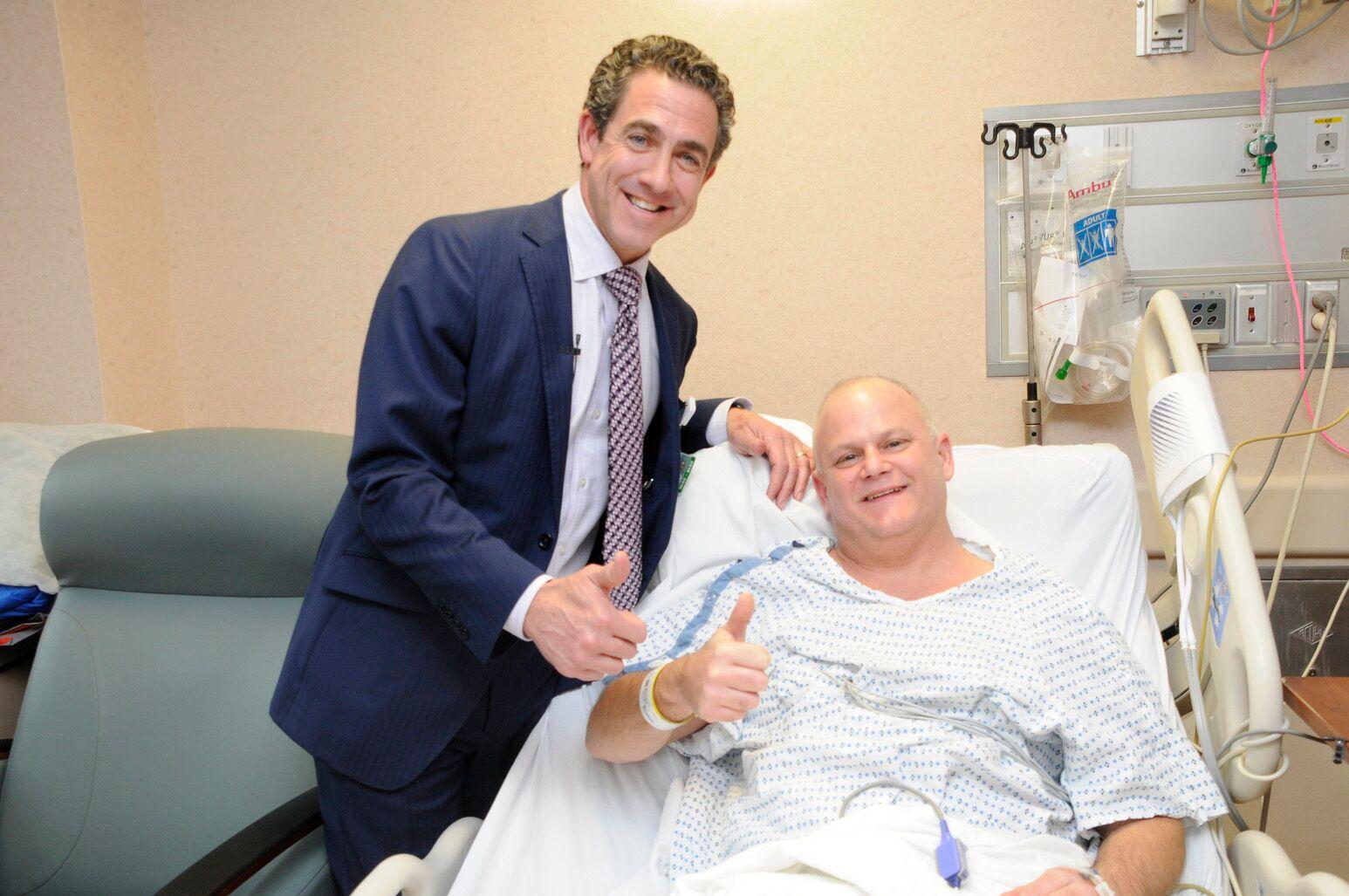 """Patient Tim Hartig and John Boockvar, MD, give """"thumbs up"""" after awake brain surgery."""