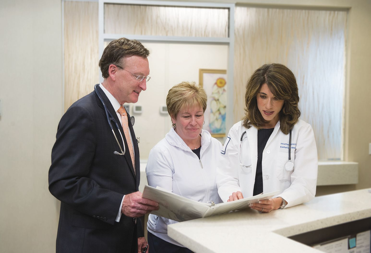Three doctors reviewing a patient chart